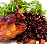 Grilled Solano County Quail with Black Japonica Rice, arugula salad, grilled pineapple salsa