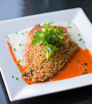 Brown rice encrusted halibut with red pepper sauce and cauliflower puree