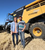 peter and carissa rystrom in front of harvester