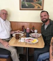 Logan Wilson with his father and son eating breakfast