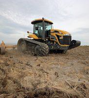 tractor doing fieldwork in rice field