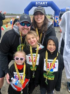 family portrait after race with medals