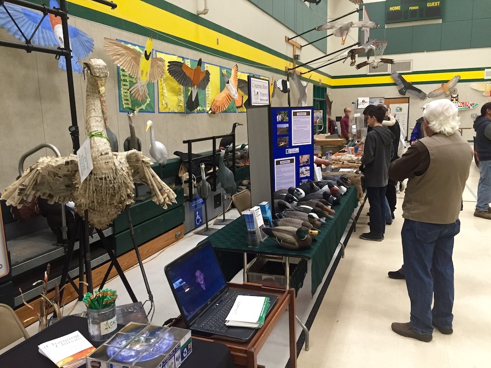 people viewing exhibits at bird festival