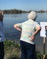 women reading dedication sign